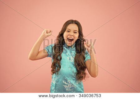 Shes A Real Winner. Little Girl Shout And Make Winner Gesture On Pink Background. Happy Small Winner