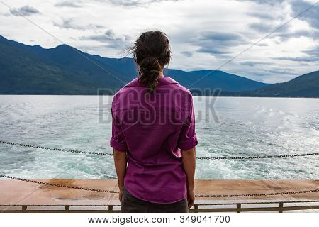 Close Up From Behind Of A Man On The Deck Of A Passenger Ferryboat. Meditative Position With Arms Re