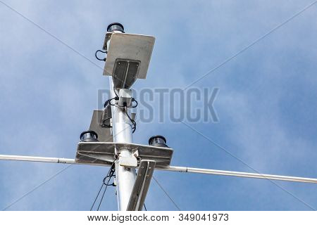 Close Up From Below Of Technical Navigation Systems Off A Passenger Ferryboat. Slightly Hazy Sky In