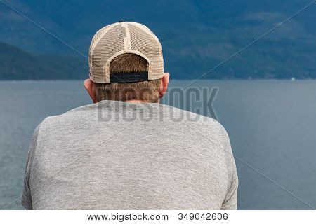 Close Up Shot From Behind Of A Young Man, Passenger Of A Ferryboat Navigating In A Canadian Lake. Pa