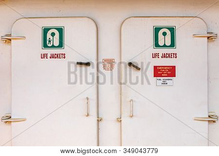Close Up Of The Doors Of The Life Jacket Compartment Room On A Passenger Ferryboat In Canada. White