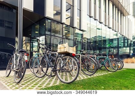 Many Bikes Parked Near Modern Apartment Residential Buiding Or College Campus At Downtown Of Europea