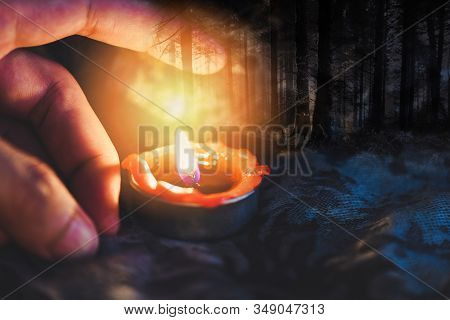 Hand With Candlelight Burning Candle On The Darkness Scary Forest Background For Astrology Occult Ma