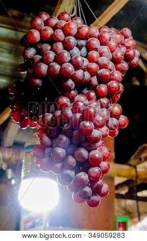 Red Grapes In A Fruit Shop With Light