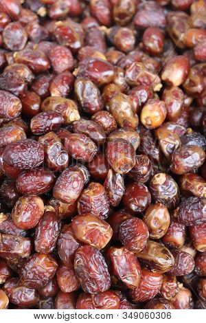 Ripe Dates Fruit Backgrounds. Pile Of Dates Fruits In A Shop