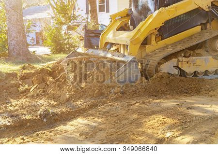 Close Up Of Bulldozer Scoop Moving Earth In Preparation Landscaping Works