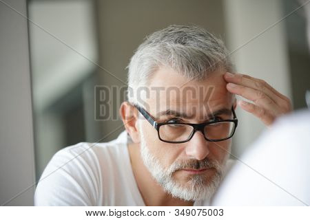 Portrait of man concerned by hair loss