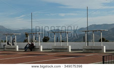 Alora, Spain - February 01, 2020: People Shooting The Breeze At Large Tiled Viewpoint In Andalusian
