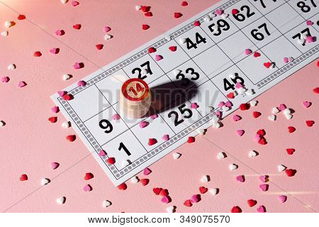 Lotto Ticket With Wood Barrel 14 Number On Pink Hearts Background. Valentines Day 14 February Minima