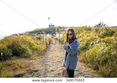 Cute Girl At Area Of Daikanbo Observatory. One Of Beautiful Landmark Viewpoint Of Aso With Green Gra