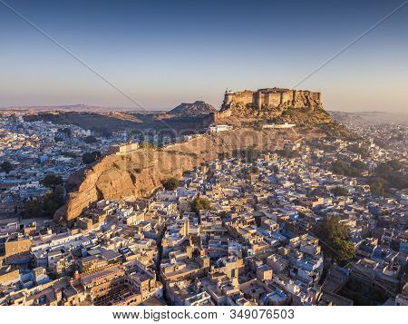 Aerial View Of Mehrangarh Fort At Sunset Sits Above The 'blue City' Jodhpur, Rajasthan State.