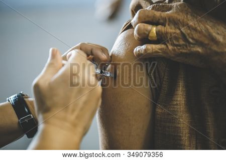 The Patient Is Vaccinated In The Arm To Prevent Influenza: The Concept Of Disease Prevention