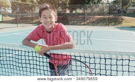 Mixed Asian Preteen Boy With Tennis Ball And Racket, Tween Sport, Kid Active Activities, School Camp