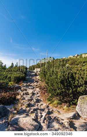 Stone Hiking Trail On Szrenica Hill With Hut In Karkonosze Mountains In Poland