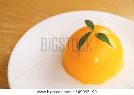 Delectable Mandarin Orange Dome Cake On White Plate With Copy Space