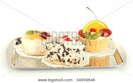 sweet cakes with fruits and chocolate on silver tray isolated on white