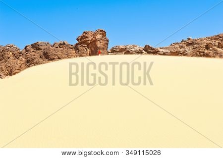 Lonliess And Vastness  - Desert Landscape With One Man In The Background In The Eastern Part Of The