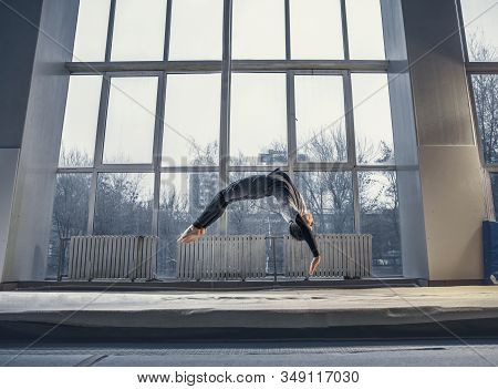Flying. Little Male Gymnast Training In Gym, Flexible And Active. Caucasian Fit Little Boy, Athlete