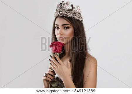 Beautiful Like A Flower. Woman Holding A Red Rose Looking At You The Camera Isolated White Backgroun
