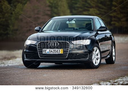 Grodno, Belarus - December 2019: Audi A6 4g, C7 2.0 Tdi 190 Hp 2016 Outdoors On Winter Road During T