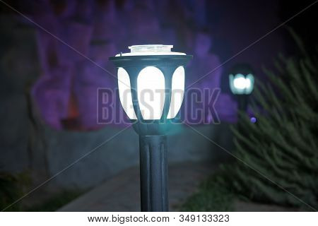 Lanterns In The Garden. The Backdrop Is Bush That Little Light. Magic Street Lamp Close-up With Copy