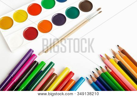 Set Of Tools For Painting - Colored Pencils, Felt-tip Pens, Watercolor Paints And Brushes Close-up O
