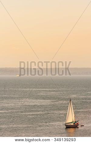 Sailing On The Yacht Across Puget Sound Near Seattle At Sunset, Washington, Usa