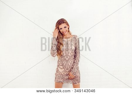 Sexy And Happy. Close Up Portrait Of Elegant Luxurious Woman In Trendy Gold Sequin Party Dress Isola