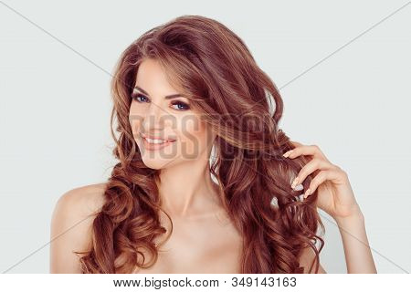 Beautiful Woman Touching Curly Hair. Beauty Spa Middle Age Woman With Perfect Fresh Skin And Hair. P