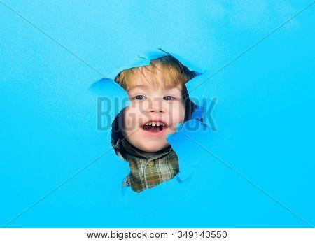 Through Paper. Happy Boy Looking Through Paper. Kid Looking Through Paper. Boy Breaks Paper. Sale An