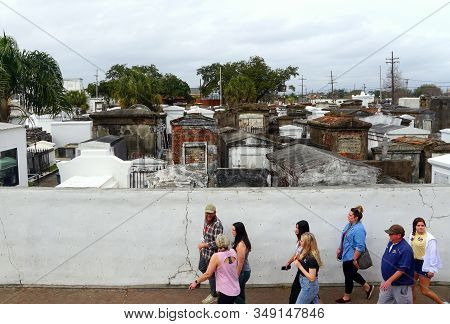 New Orleans, Louisiana, U.s.a - February 4, 2020 - Tourists Enjoying The Cemetery Tour On Rampart St