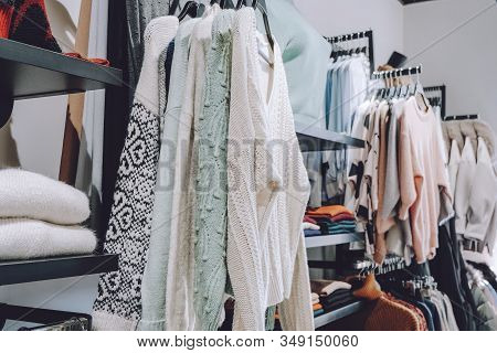 Sustainable Living, Zero Waste Wardrobe. Secondhand Fashion. Various Clothes On Hangers On Shelves A