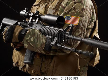 Front View Of Incognito Military Officer Holding Sniper Rifle. Crop Of American Soldier In Uniform A
