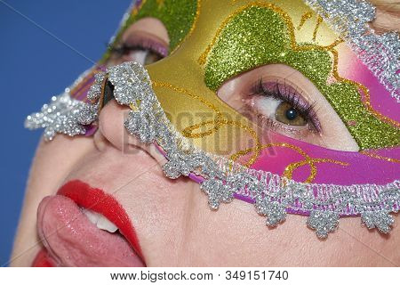 Closeup Portrait Of Woman In Mardi Gras Masquerade Mask In Complementary Art Style. Funny Face Durin