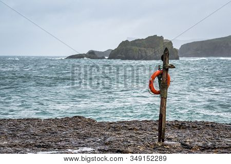 A Life Preserver Hanging On A Pole By The Ocean On The Antrim Coast In Northern Ireland To Easyaly B