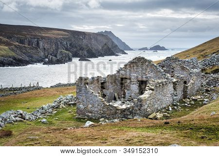 The Ruins Of An Old Famine Stone Built Cottage On A Remote Part Of The Irelands West Coast In County
