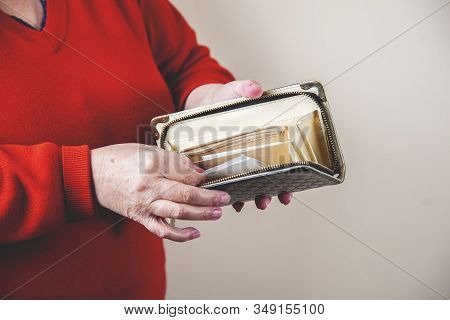 Woman Hand Wallet On Grey Wall Background