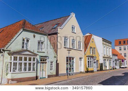 Tonder, Denmark - June 26, 2019: Colorful Houses At A Cobblestoned Street In Tonder, Denmark
