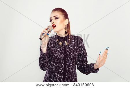 Singer. Woman Playing Singing At Microphone With All Her Passion Heart Force Eyes Closed Isolated Wh