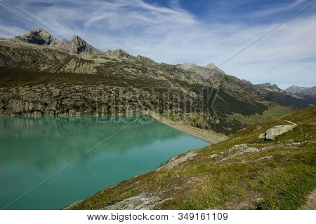 Dam At The Goescheneralp In The Central Swiss Mountatins