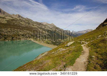 Dam Impounding Lake Goeschenen In The Swiss Alps