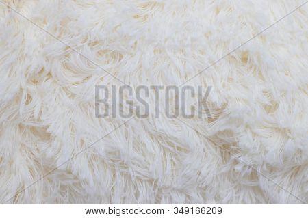 White Faux Fur Texture. Delicate Fur Milk Color.