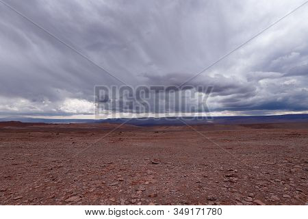 Storm Clouds In The Landscape Of The Atacama Desert. The Rocks Of The Mars Valley (valle De Marte) A