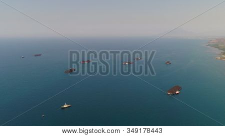 Aerial View Barges Full Coal Anchored At Sea Near Coal Fired Power Station Waiting Be Transported. C