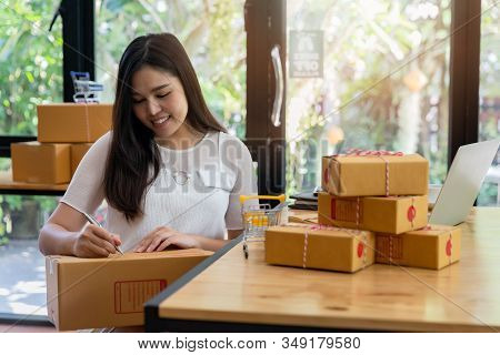 Successful Entrepreneur Business Woman With Online Sales And Parcel Shipping In Her Home Office, Pre