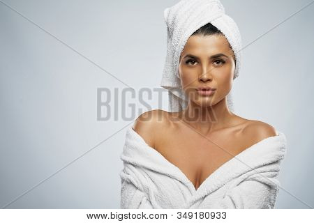 Front View Of Pretty Female With Towel On Head And In Bathrobe Posing. Portrait Of Brunette Woman Wi