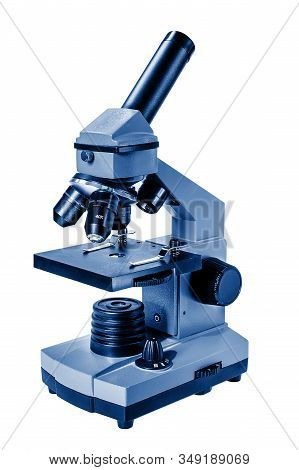 Blue Microscope On A White Background. Microscope Toned In Trendy Classic Blue Color. Science Symbol