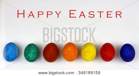 Easter Eggs. Happy Easter Card. Multi-colored Easter Eggs. Easter. Easter Eggs On A White Wooden Bac
