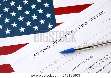 Advance Health Care Directive Blank Form And Blue Pen On United States Flag
