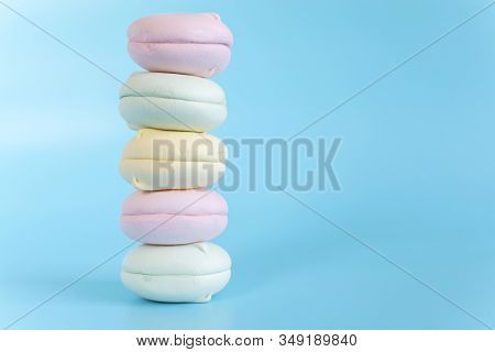 Air Marshmallows In Pastel Shades. A Gentle Marshmallows. A Gentle Zephyr On A Blue Background. Mars